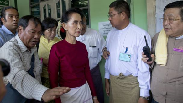 Aung San Suu Kyi goes to vote, a right denied to the Rohingya.